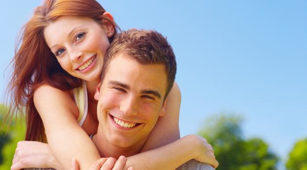 Woman embracing her boyfriend